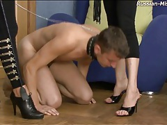Slave guy on a leash licks feet of mistresses tubes
