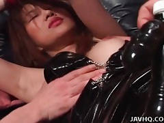 Kinky bound slut in latex and fishnets tubes