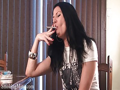 Smoking girl teases in sexy stockings tubes