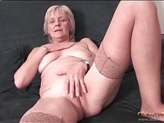 Granny strips to stockings and fingers pussy tubes