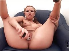 Glamorous blonde girl fucks pussy with dildo tubes