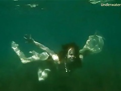 Young lady goes skinny dipping in the ocean tubes