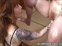 Asian bondage babe is fisted tubes
