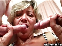 Old lady in bathrobe strokes younger cocks tubes