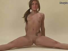 Tanned brunette is flexible and naked tubes