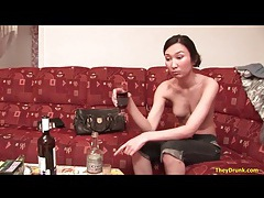 Asian girl doing shots and drinking wine tubes
