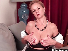 Mature lady with d-cup tits masturbates in pantyhose tubes