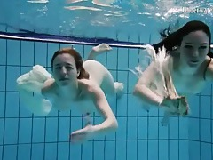 Nearly naked girls go swimming in the pool tubes