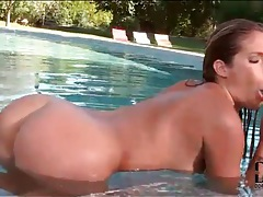 Wet girl in the pool has fun with anal toy tubes