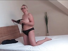 Granny in glasses plays with her pussy tubes