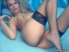 Skinny gal in fishnets masturbates on webcam tubes