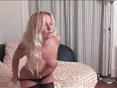 Sexy milf stunner in heels and stockings plays tubes
