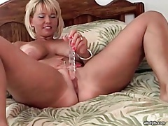 Blonde with fake tits fucks a dildo tubes