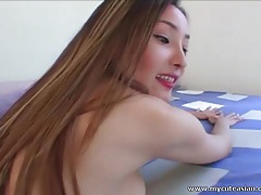 Asian amateur shows off her cute shaved pussy tubes