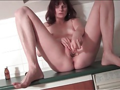 Small breasts milf fucks pussy with dildo tubes