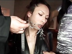 Asian dickgirl in black leather bound tubes