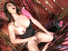 Delicious asian tranny jerks off and cums on her bed tubes