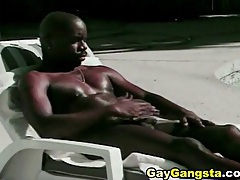 Black stud soaks up the sun and sucks cock tubes