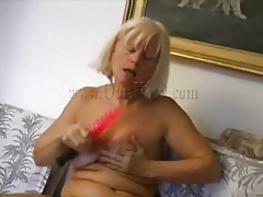 Blonde granny masturbates with red dildo tubes