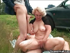 Horny mature takes dick in a field tubes