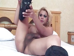 Tgirl in sexy swimsuit and boots fingers him tubes