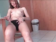 Housewife strips as she cleans her house tubes