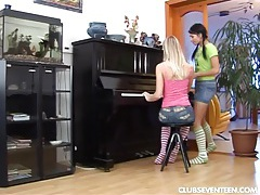 Sexy lesbians toy muffs on piano tubes