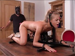 Blonde in kinky bondage fucked by toy tubes