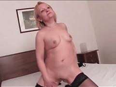 Horny solo mature masturbates in stockings tubes