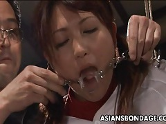 Hot asian cheerleader enjoys a round of bdsm. tubes