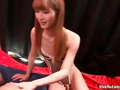 Asian shemale jerks him off with soft hand tubes