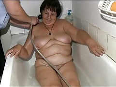 Nurse gives chubby old lady a bath tubes
