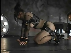 Kinky japanese sub in fishnets and bondage tubes