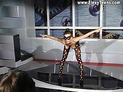 Flexible brunette models stockings and heels tubes