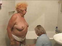 Granny gets a bath from her nurse tubes