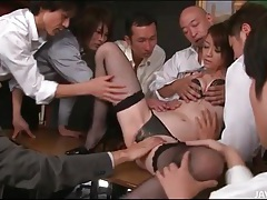 Group of guys fondle japanese secretary tubes