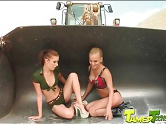 Two sluts ass fucked in the sand tubes
