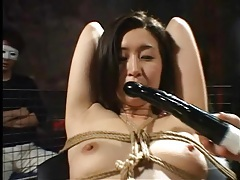 Audience watches bound japanese girl fuck toy tubes