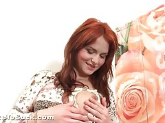 Redhead strips and drops to her knees to suck cock tubes