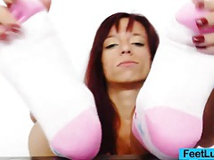 Redhead gives stirring footjobs to dildo tubes