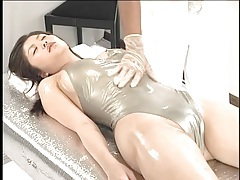 Shiny swimsuit on japanese girl getting a massage tubes