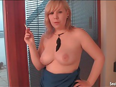 Chubby chick smokes and takes out her tits tubes