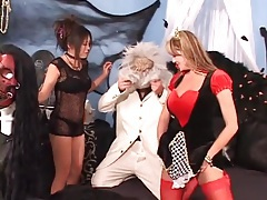 Two costume girls suck his dick lustily tubes