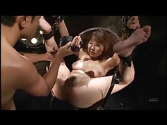 Submissive girl put in bondage and fingered tubes