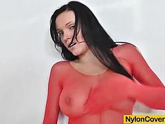 Busty model ema black face deformed by a nylon mask tubes