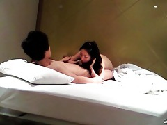 Asian brunette blows her boyfriend in bed tubes