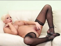 Bimbo in black stockings plays solo tubes