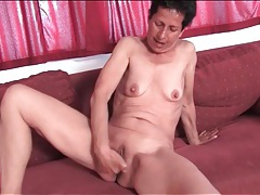 Granny fingers her wet bald pussy tubes