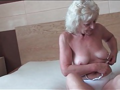 Granny lubes and fingers her sexy pussy tubes