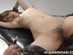 Nasty asian slut in bondage gets her muff teased tubes